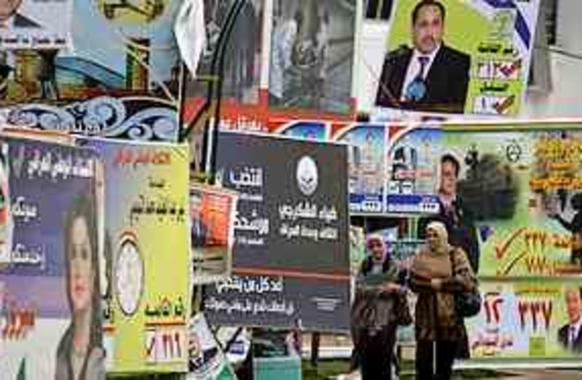 Iraqis election posters 311 (photo credit: Associated Press)