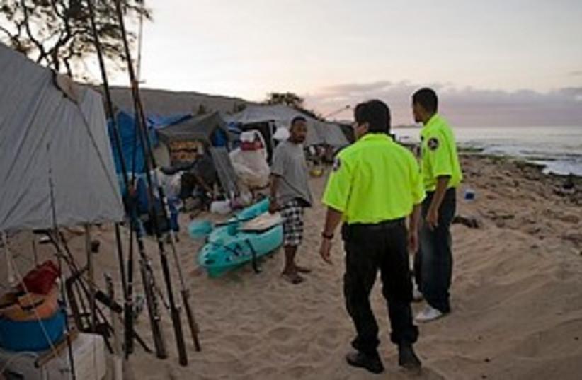 tsunami hawaii cops in yellow cool 311 ap (photo credit: ASSOCIATED PRESS)