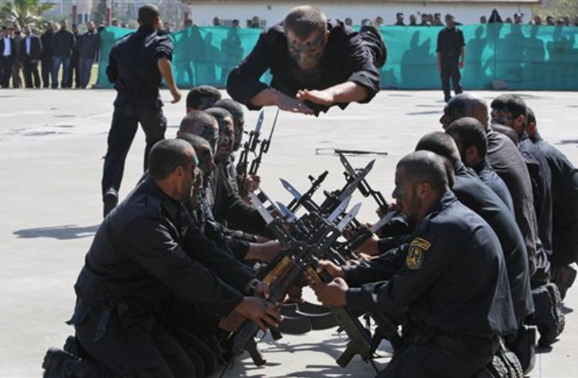 Hamas security forces demonstrate their skills (photo credit: AP)