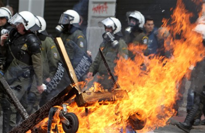 Riot police in Athens, Greece (photo credit: AP)