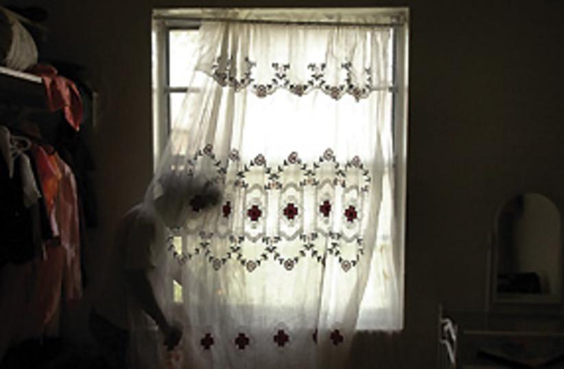 rape victim illustrative 311 (photo credit: John L. White / South Florida Sun-Sentinel / MCT)