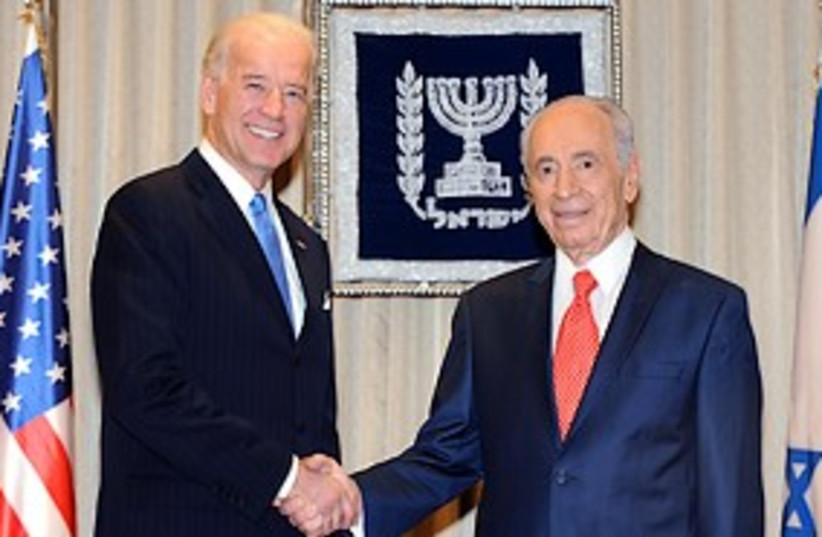 biden and peres shake hands in israel 311 GPO (photo credit: GPO)
