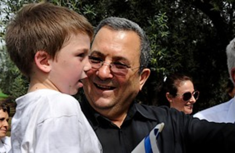 barak with kid smiling 311 MOD (photo credit: Ariel Hermoni / Defense Ministry)