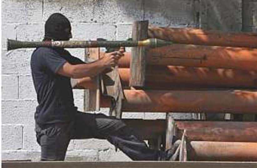 Hamas man rocket 298.88 (photo credit: AP [file])