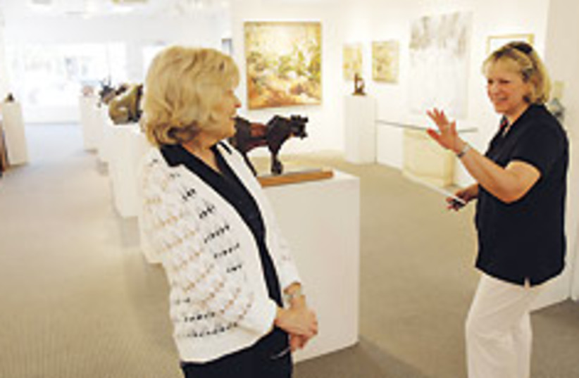 Leslie Levy (left), who has owned an art gallery i (photo credit: AP)