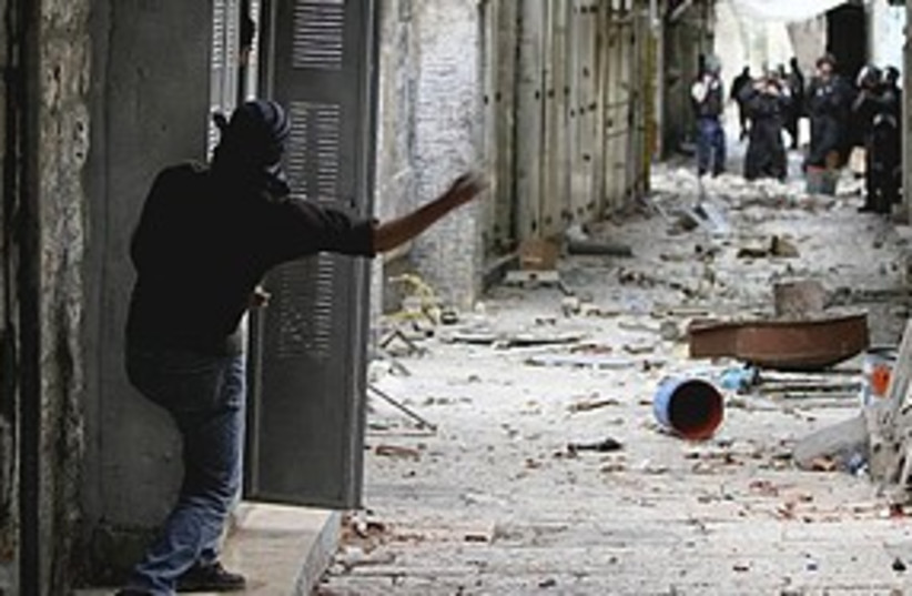 Arab throws stones 311 (photo credit: Associated Press)