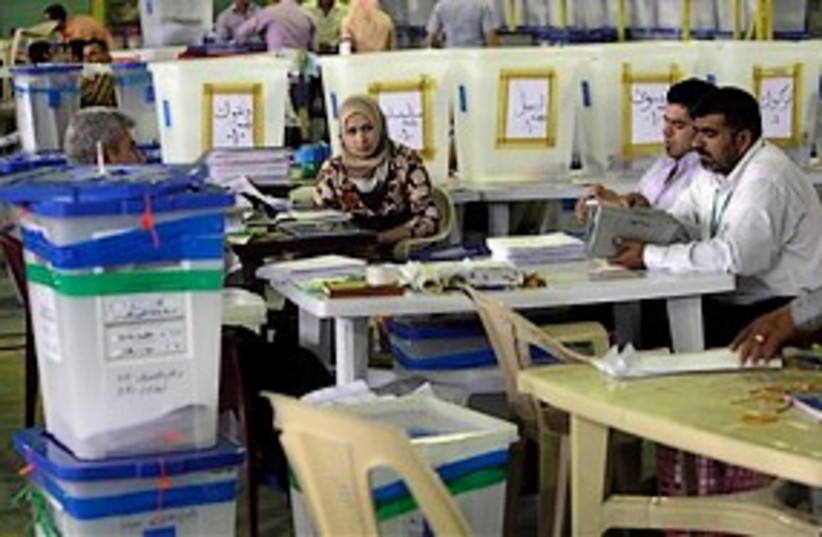 Iraqi Electoral workers 311 (photo credit: Associated Press)
