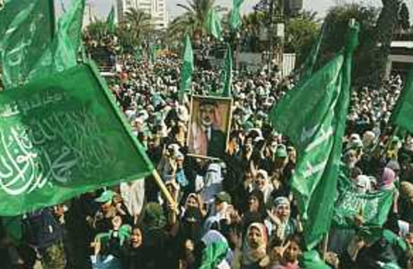 hamas rally flags 289.88 (photo credit: AP)