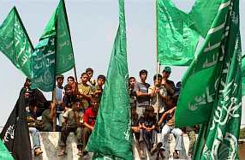 hamas holding flags 298. (photo credit: AP)