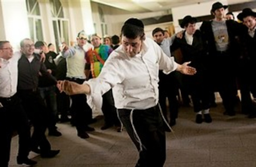 berlin jews dance purim germany 311 ap (photo credit: AP)