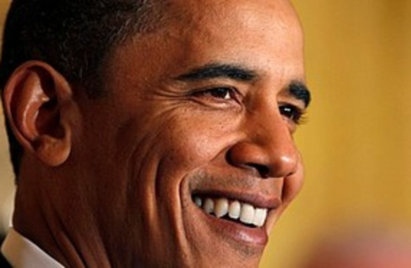 Obama smiles 311 (photo credit: Associated Press)