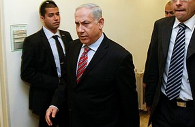 netanyahu arrives at cabinet meeting 311 (photo credit: Associated Press)