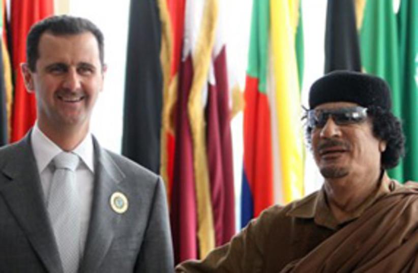 Gahdafi and Assad (photo credit: AP)