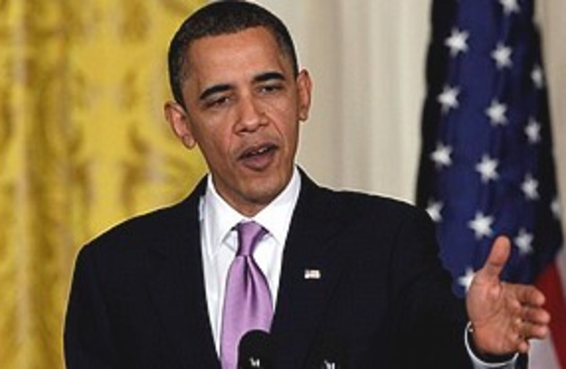 Obama chops 311 (photo credit: Associated Press)