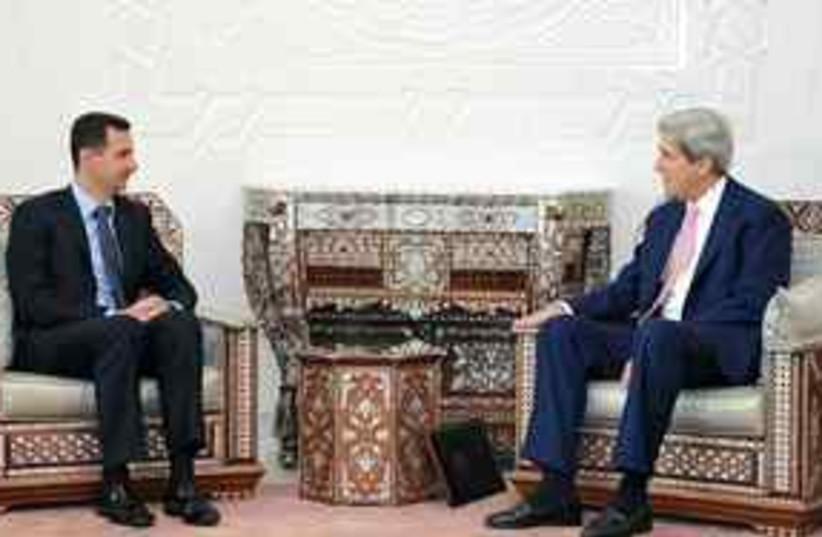assad and kerry (photo credit: AP)