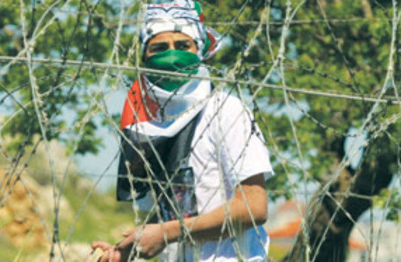 palestinian rioter 311 (photo credit: AP)