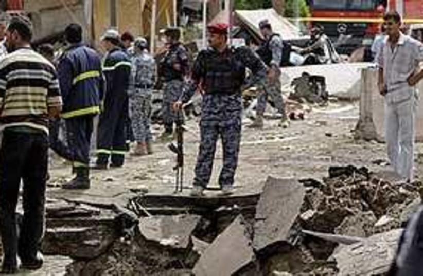 Iraq bomb rubble 311 (photo credit: Associated Press)