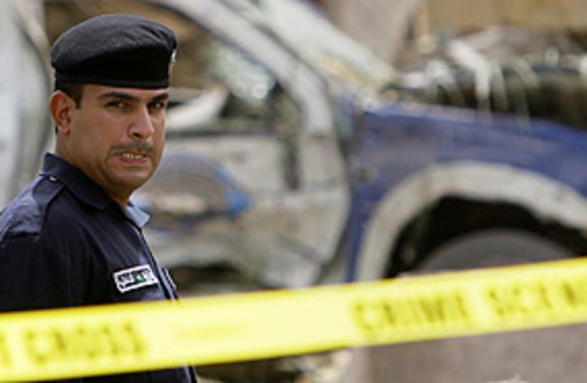 baghdad bomb police 311 (photo credit: AP)
