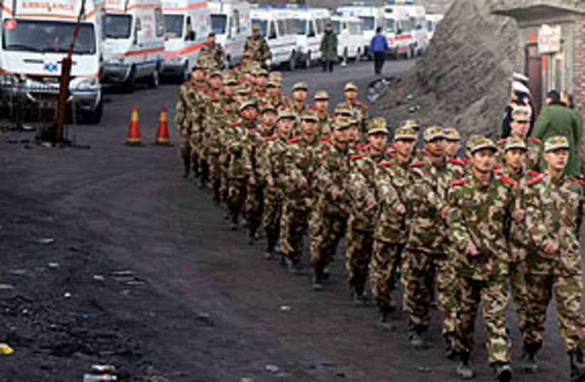chinese police mine 311 (photo credit: AP)