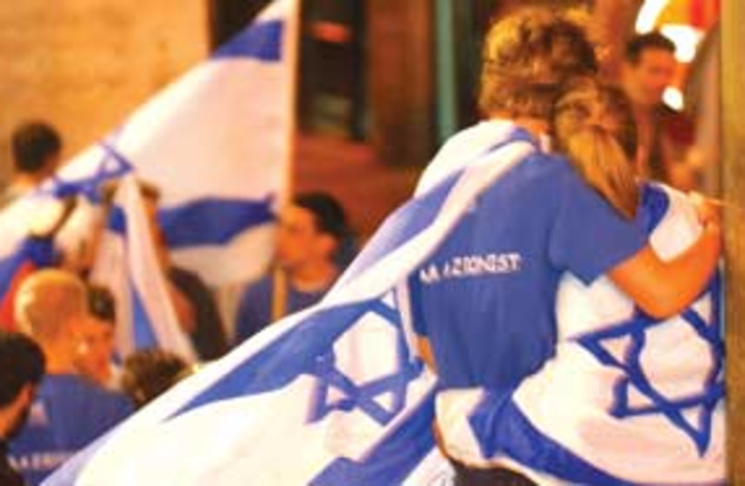 israel flag draped 311 (photo credit: Ariel Jerozolimski)