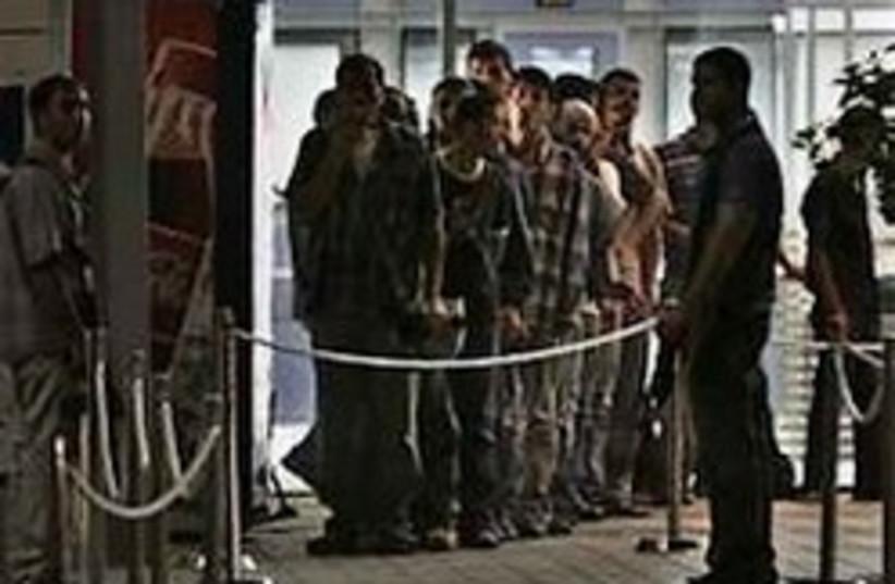 Erez Crossing Waiting 248.88 (photo credit: AP [file])