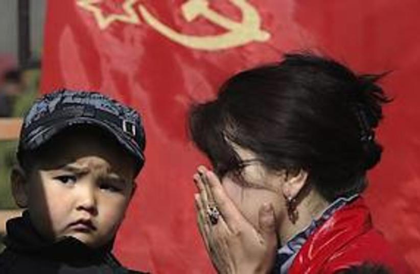 kyrgyz woman mourns 311 (photo credit: AP)