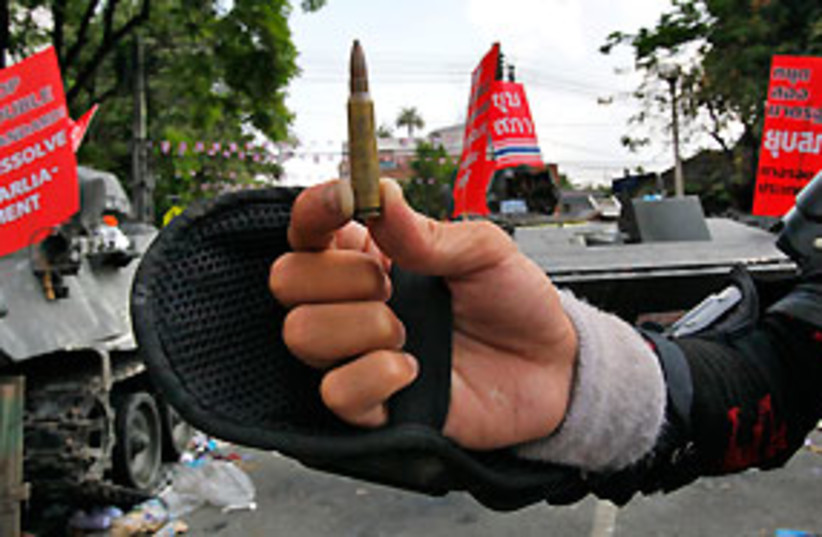 thailand bullet red guard 311 (photo credit: AP)