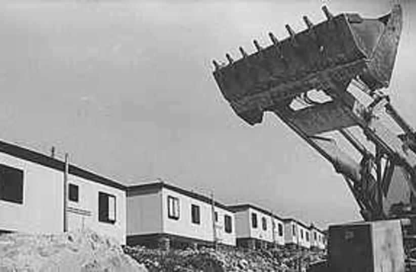 Settlement construction (photo credit: .)
