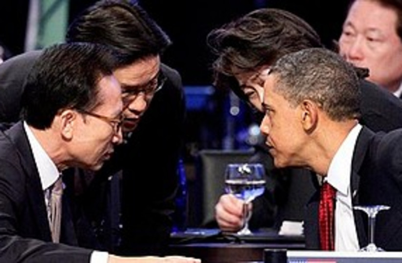 Obama chats at nuke summit 311 (photo credit: ASSOCIATED PRESS)