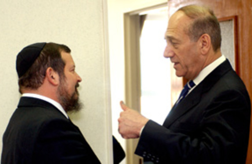 olmert with lopolianski 311 (photo credit: Ariel Jerozolimski [file])