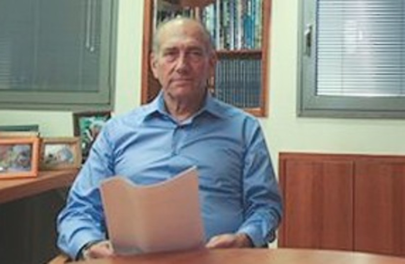 Olmert reads statement 311 (photo credit: Associated Press)
