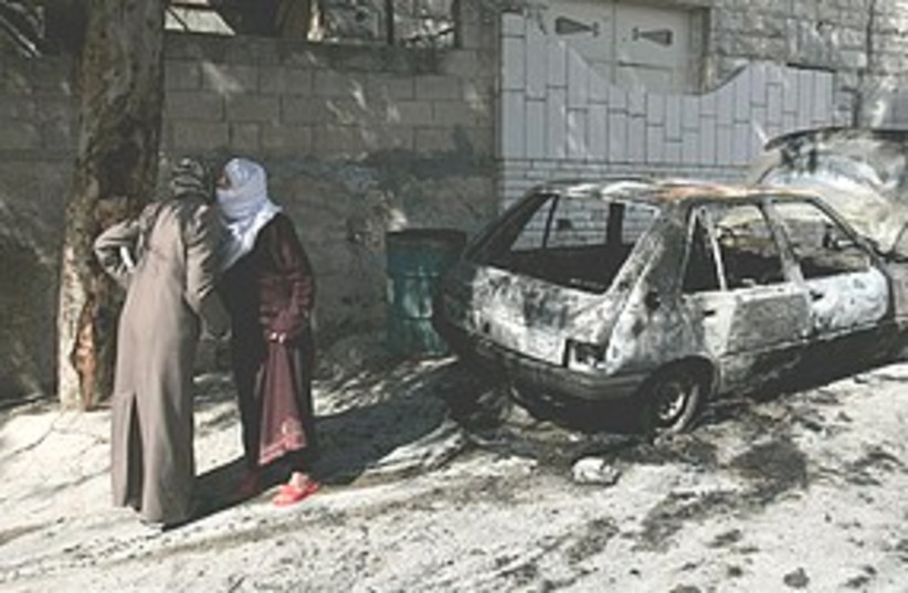 Torched car in West Bank 311 (photo credit: Associated Press)