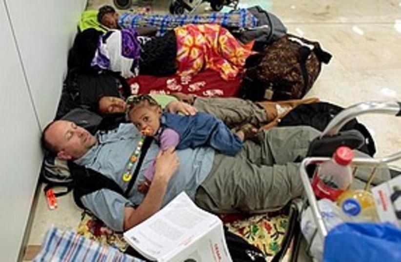 Travelers wait at Madrid airport 311 (photo credit: Associated Press)