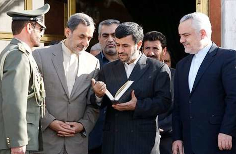 ahmadinejad Koran 311 (photo credit: Associated Press)