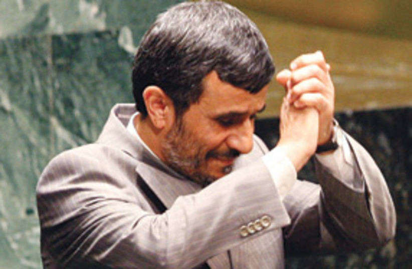 ahmadinejad hand clap 311 (photo credit: AP)