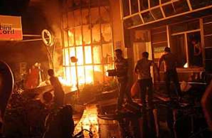 iran gas burning 298.88 (photo credit: AP)