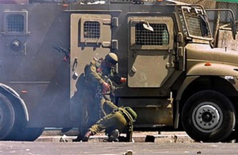soldier falls in Nablus  (photo credit: AP)