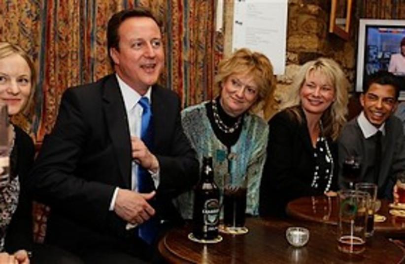Cameron in pub 311 (photo credit: Associated Press)