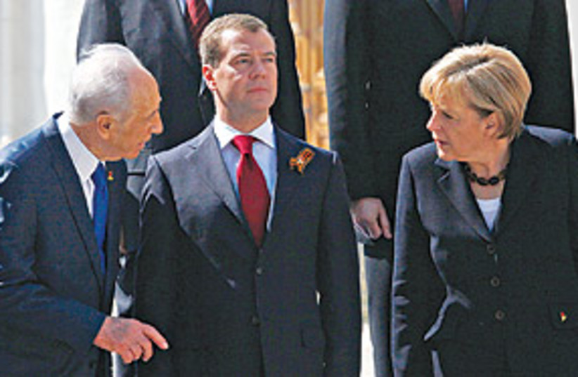peres medvedev merkel 311 (photo credit: AP)