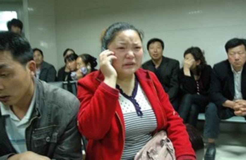 Chinese school attack (photo credit: ASSOCIATED PRESS)
