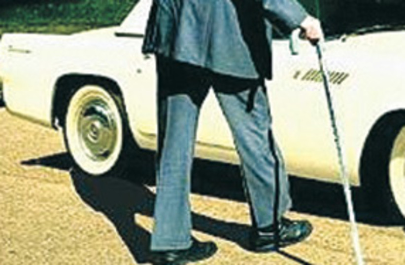 Old man walking with a cane 311 (photo credit: AP)