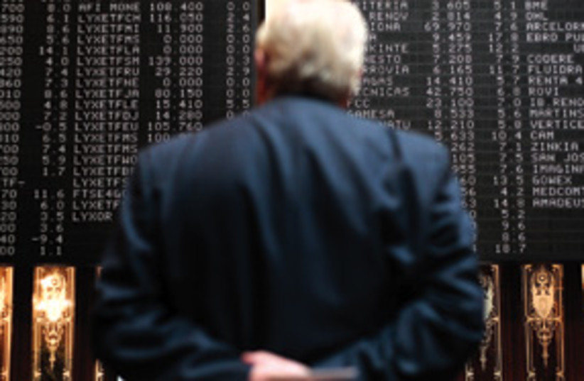 Trader watches the stocks 311 (photo credit: AP)