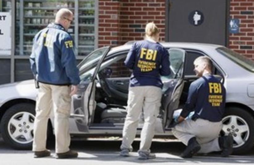 FBI ssearch car (photo credit: ASSOCIATED PRESS)