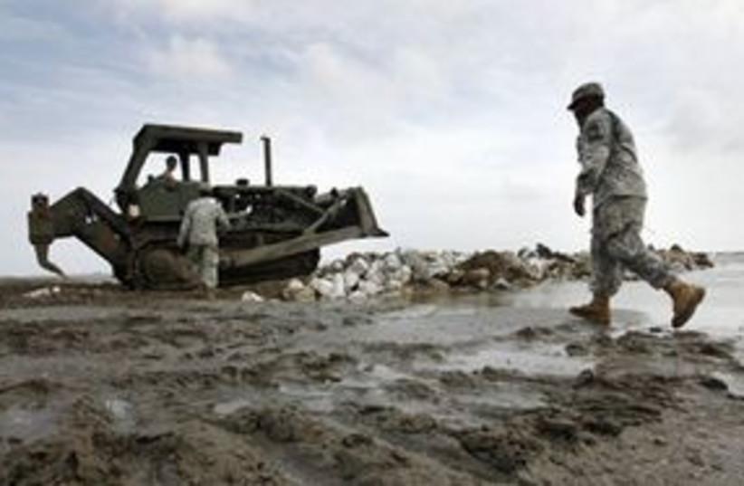 louisiana oil spill beach 311 (photo credit: AP)