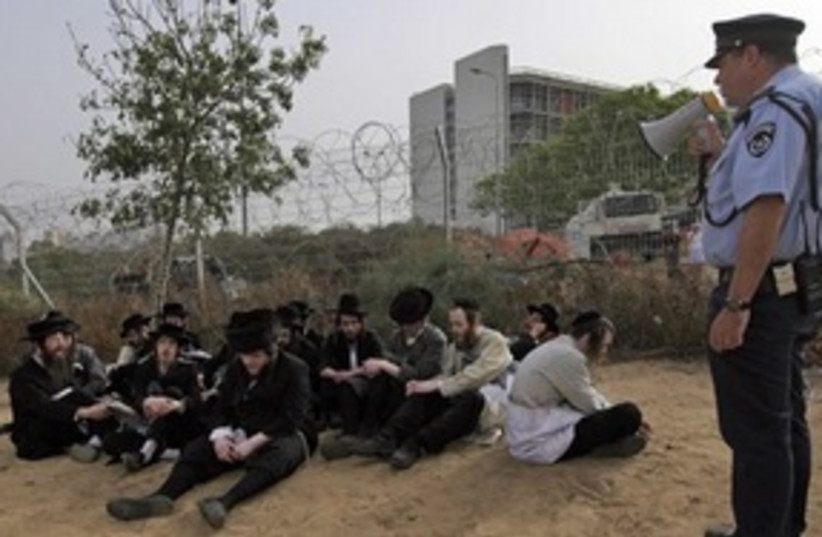 haredim detained at Barzilai (photo credit: ASSOCIATED PRESS)