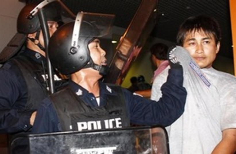 Thai protester arrested (photo credit: ASSOCIATED PRESS)