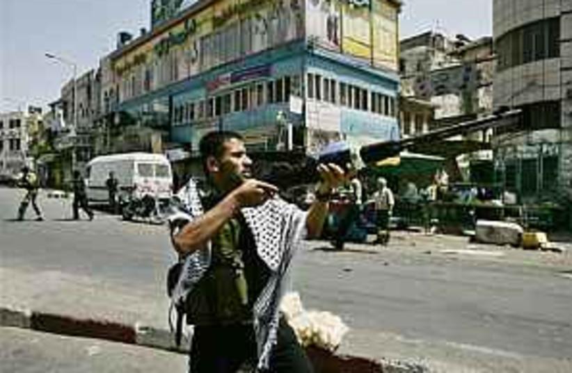 A Fatah gunman in Nablus (photo credit: AP)