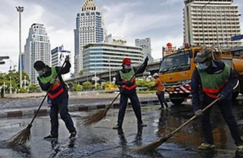 Thai sweepers 311 (photo credit: ASSOCIATED PRESS)