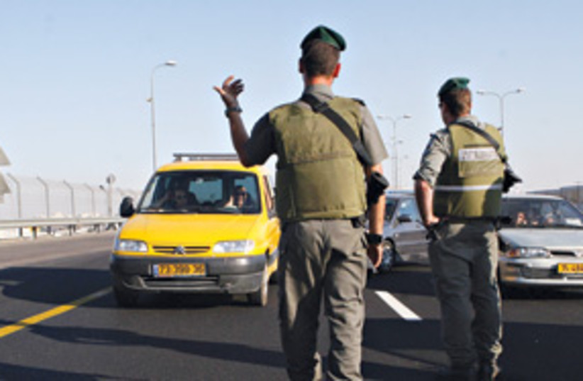 Soldiers open highway 443 311 (photo credit: Ariel Jerozolimski/The Jerusalem Post)
