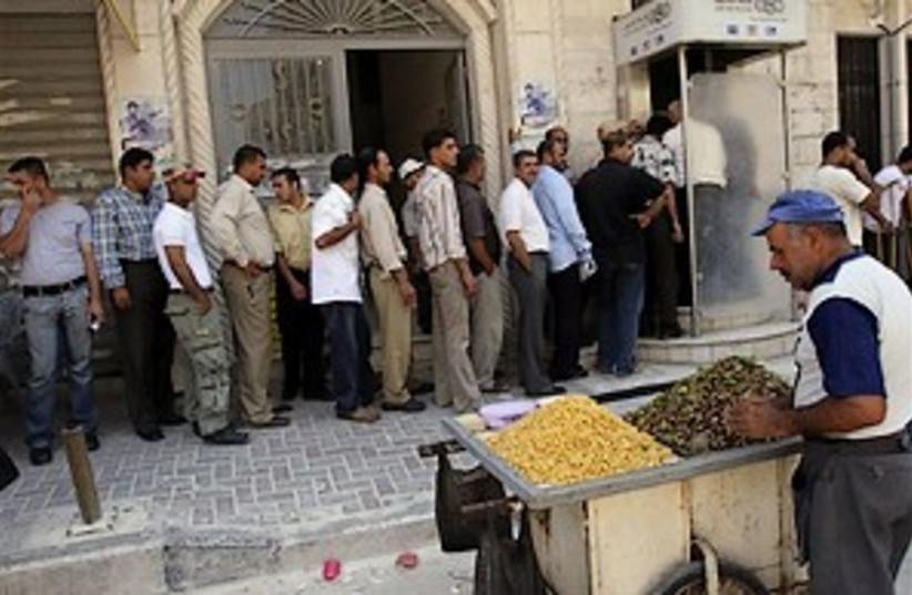 palestinian salary 298.8 (photo credit: AP)